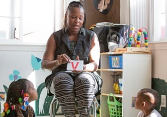 preschool teacher reads to kids at a family daycare